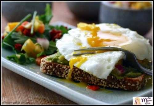 fried eggs on toast with avocado