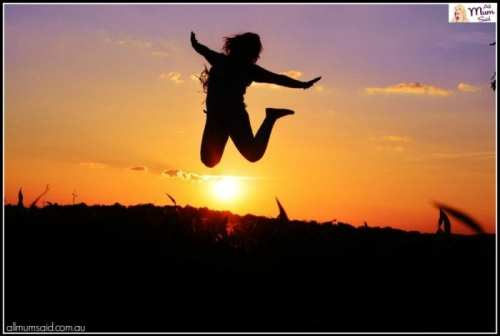 live free lady jumping high in the air with sunset | fuck it
