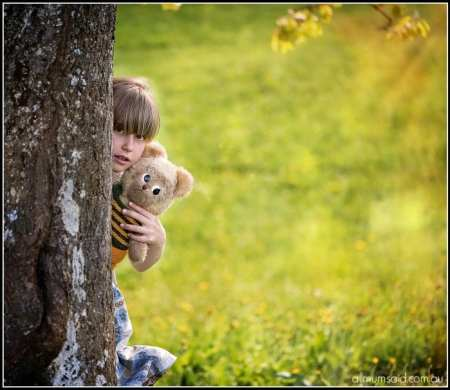 child safety kid behind tree