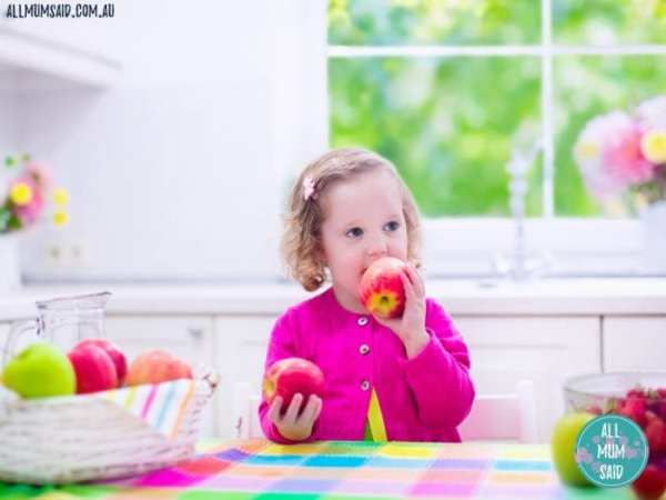 Prepare your child for school | girl eating apple
