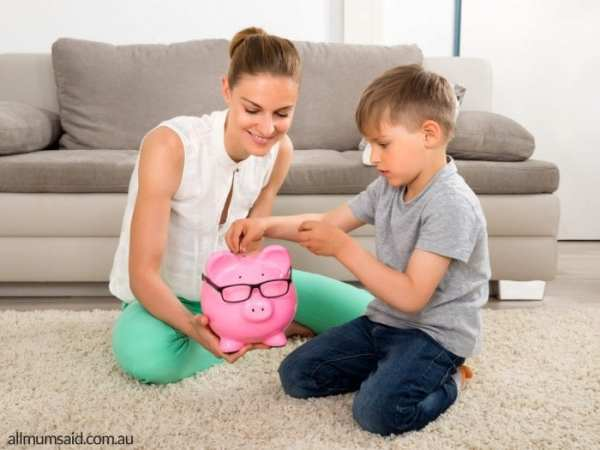 Ways to tech kids to save | mum and son putting money into piggy bank