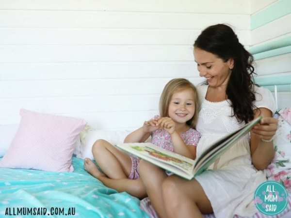 mum reading bedtime story to daughter