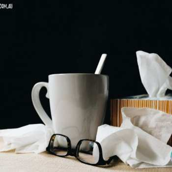 stuff you need when sick   cup of tea and tissues