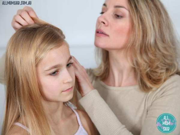 How to deal with head lice _ mum checking daughters hair for nits
