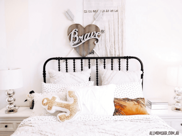 cosy kids bedroom with cushions and wall art