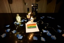 Table decorated with fairy lights and flower petals