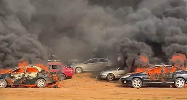 Hoodlums Attack EndSARS Protesters, Set Cars Ablaze In Abuja