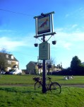 The Fox Inn sign and vintage bike.