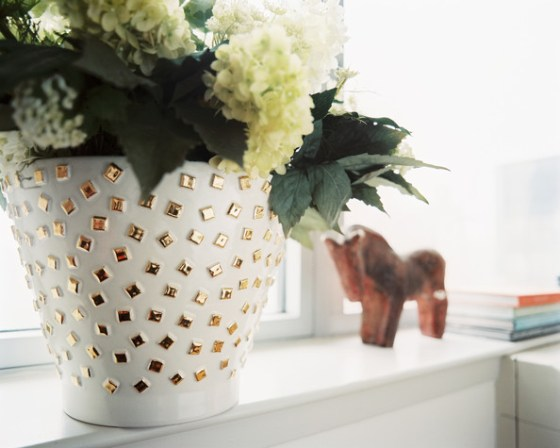 Glammed up vase (might even make the flowers inside jealous!) (via)