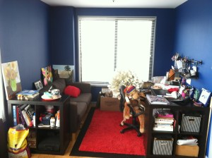 My crafting nook. Once a giant dining area, broken into it's own space with layered rugs and ikea bookshelves