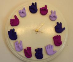 ASL Clock via https://www.etsy.com/listing/72446234/unique-sign-language-clock-telling-time?ref=v1_other_1