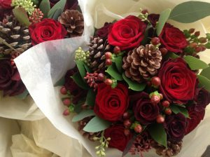 Wedding Flower Arrangements with Roses and Pinecones