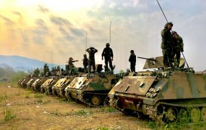 Army Man Image with Picture of The Royal Thai Army - Soldiers on Battle Tanks