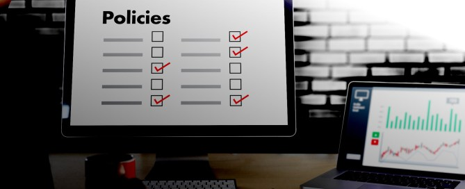 Social Media Policy desktop and laptop on desk
