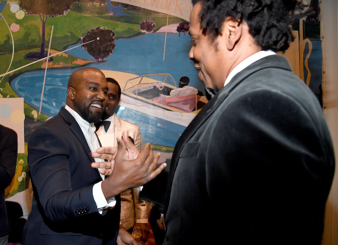 Jay-Z and Kanye West shaking hands reunited