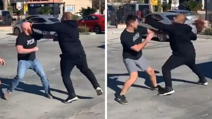 Image of Wack 100 fighting with two men