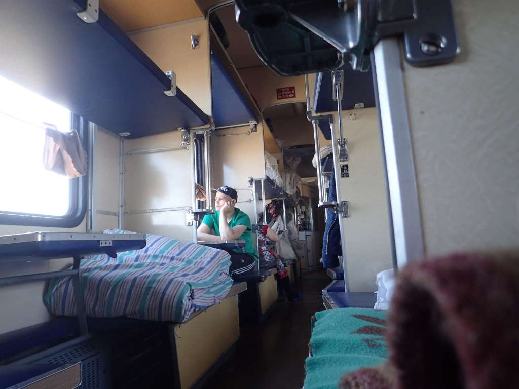 Welcome to platzkartny. See here the two beds on the opposite window (plus Igor looking contemplative)