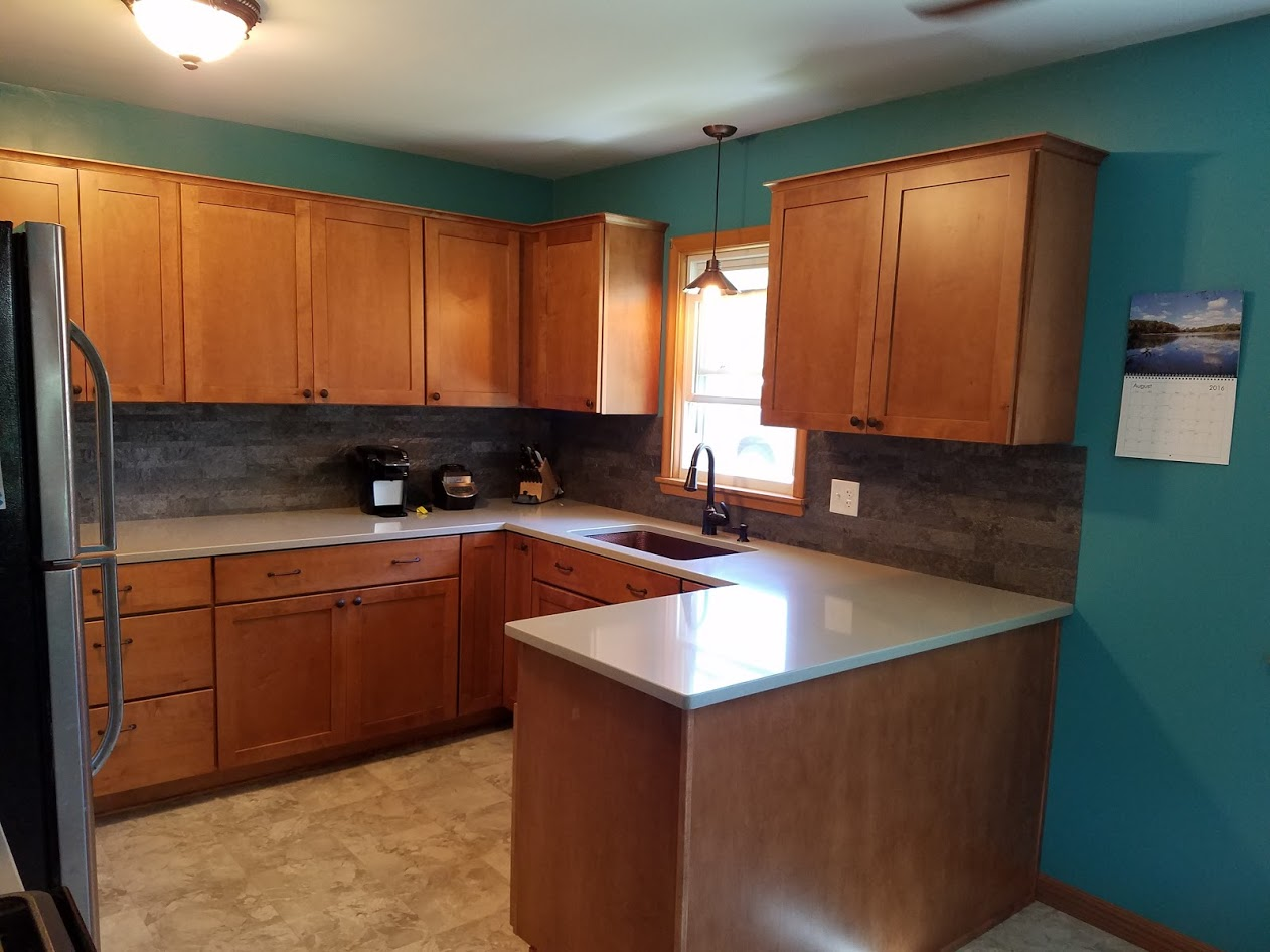 maple countertops kitchen faucet repair remodel with cabinets and hanstone quartz