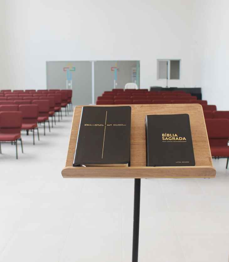 the holy bible on lectern