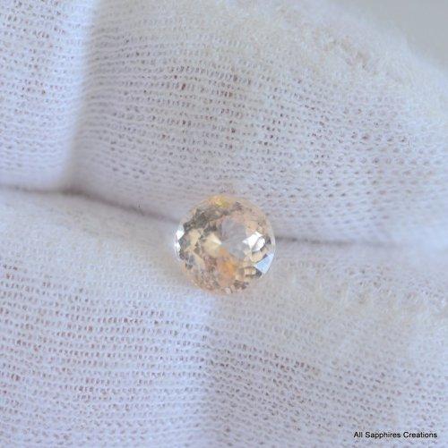 Round champagne peach sapphire