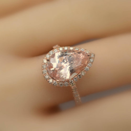 rose gold engagement ring with peach sapphire