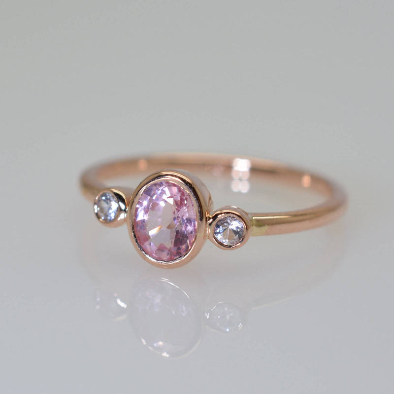oval peach champagne sapphire ring