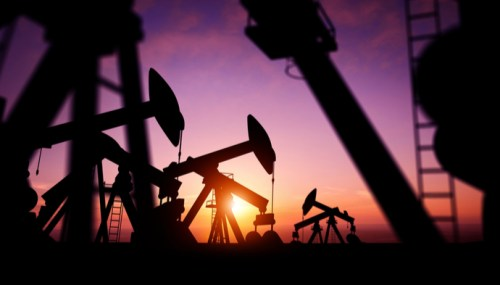 oil rigs in the dusk describing commodities in the all seasons portfolio