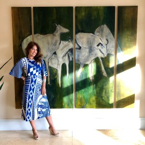 standing in front of mural painting at Ritz Carlton