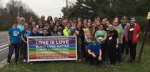 "Image of Youth with Banner Proclaiming ""Love is Love"""