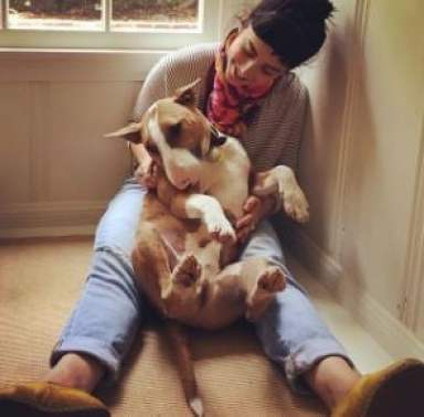 Molly Ephraim playing with her dog