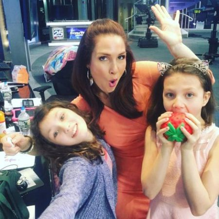Shiri Spear at her work place with her daughters