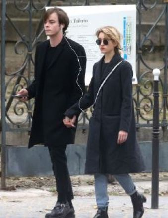 Charlie Heaton holding hands of his co-star, Natalia Dyer in Paris