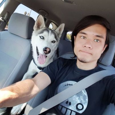 Matt Stonie with his dog named Husky