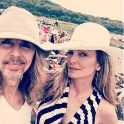 Jeanne's husband, Tommy attending a horse race