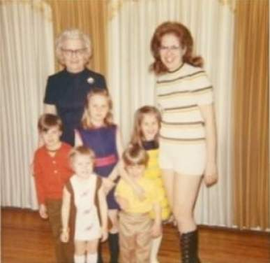 Carloe in her childhood with her family