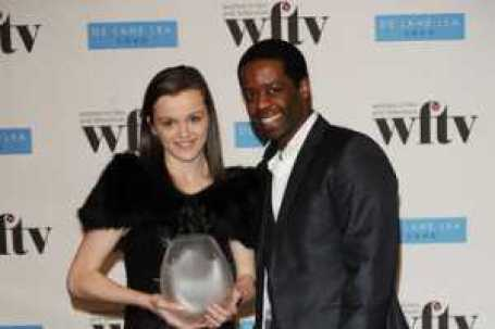 Katie Jarvis with Adrian Lester in an Award ceremony