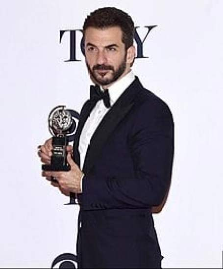 Michael Aronov winning a Tony Award for his performance in Oslo.