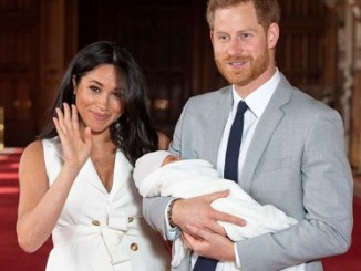 Prince Harry and Meghan Markle with their son