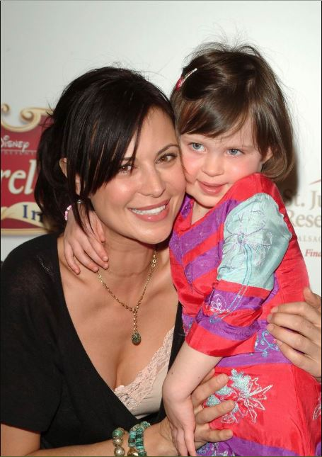 Childhood photo of Gemma Beason with her mother at Cinderella III A Twist in Time DVD Release Benefiting St. Jude Children Research.