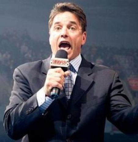 Photo of Mike Adamle while hosting.