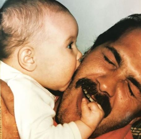 Childhood photo of Lauren Koslow with her father.