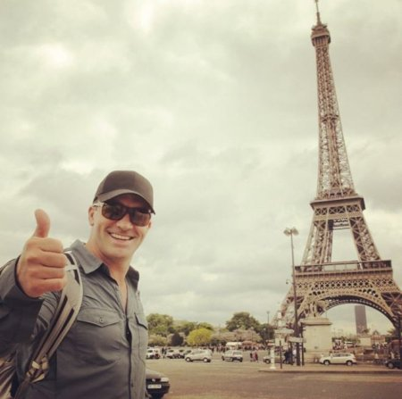 Cyril Chauquet taking photo aside Eiffel Tower in Paris, France.