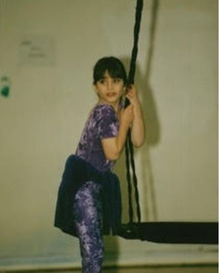Childhood photo of Ariana Gradow while practicing gymnastic.