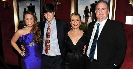 Sean Tuohy seems happy along with his wife and children