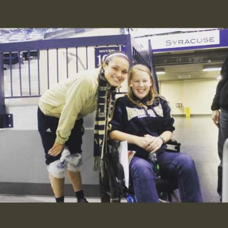 Kayla McBride taking a photo with her lovely fan.
