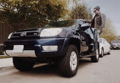Chris McNally Standing in his brand new Toyota V4 bought in an expensive rate