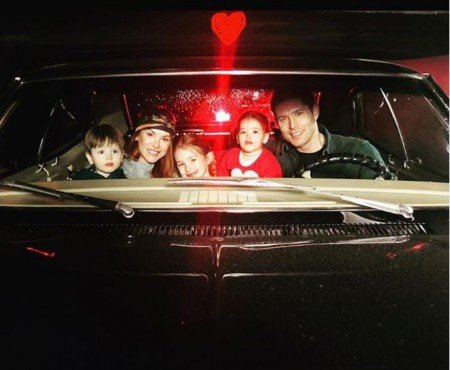 Ackles family photo inside their car