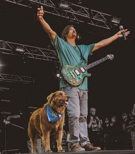 Scott Woodruff while in a concert with his pet dog