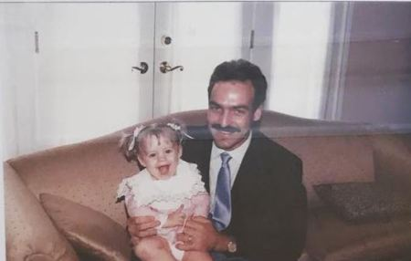Childhood image of Allie Wood along with her father