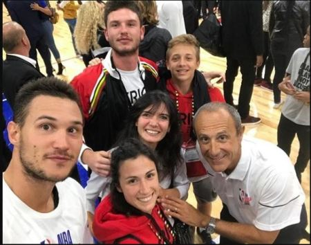 Ettore Messina with his team